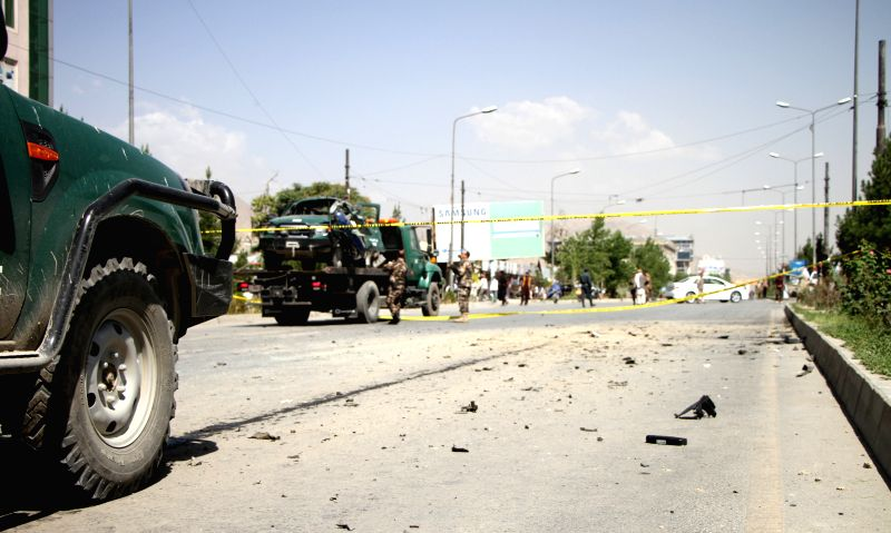 Afghan policemen inspect the site of blast in Kabul, Afghanistan, July 10, 2014. Earlier in the day, one civilian and one police were killed and four others wounded ..