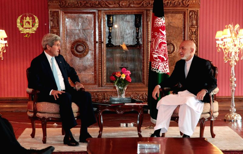 U.S. Secretary of State John Kerry (L) meets with Afghan President Hamid Karzai at the Presidential Palace in Kabul, Afghanistan, July 11, 2014. U.S. Secretary of ...