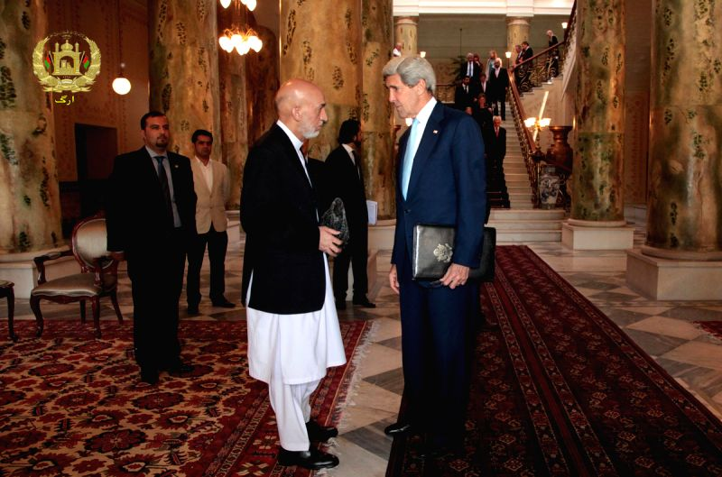 U.S. Secretary of State John Kerry (R) meets with Afghan President Hamid Karzai at the Presidential Palace in Kabul, Afghanistan, July 11, 2014. U.S. Secretary of ...
