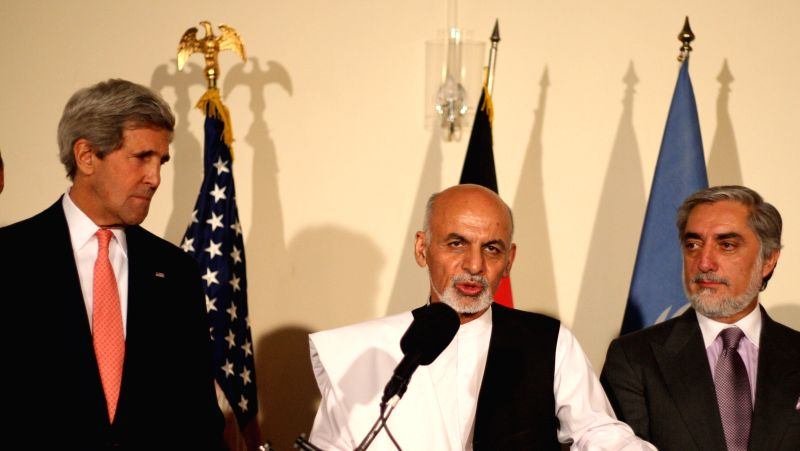 Presidential candidate Ashraf Ghani Ahmadzai (C) speaks on a joint press conference in Kabul, Afghanistan, on July 12, 2014. The Afghan presidential election standoff