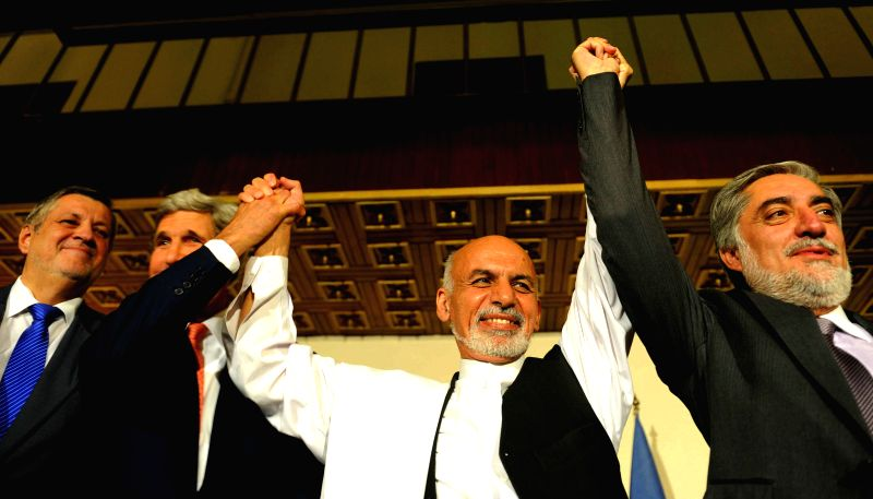 Presidential candidates Abdullah Abdullah (1st R) and Ashraf Ghani Ahmadzai hold hands after a joint press conference in Kabul, Afghanistan, on July 12, 2014. The ...