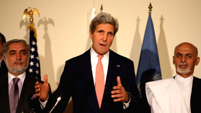 U.S. Secretary of State John Kerry (C) speaks during a joint press conference in Kabul, Afghanistan, on July 12, 2014. The Afghan presidential election standoff was ..