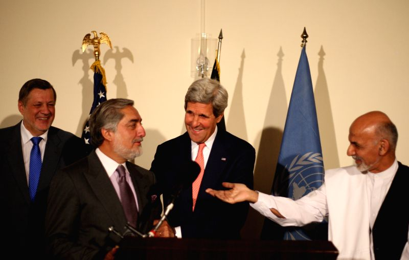 U.S. Secretary of State John Kerry (2nd R) speaks with presidential candidates Ashraf Ghani Ahmadzai (1st R) and Abdullah Abdullah (2nd L) during a joint press ...