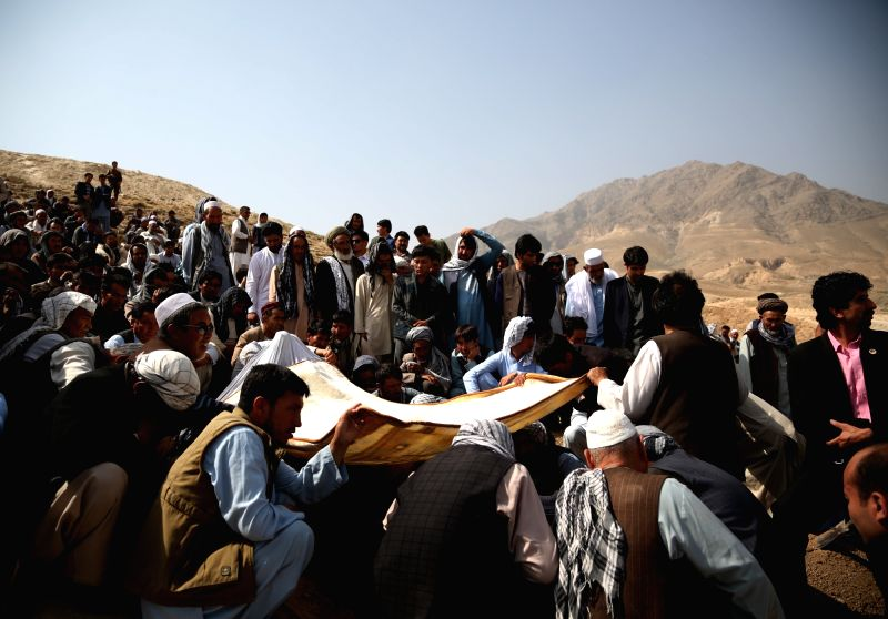 KABUL, July 16, 2018 - Friends and relatives take part in funeral of a suicide attack victim in Kabul, capital of Afghanistan, July 16, 2018. Up to 1,692 Afghan civilians were killed as a result of ...