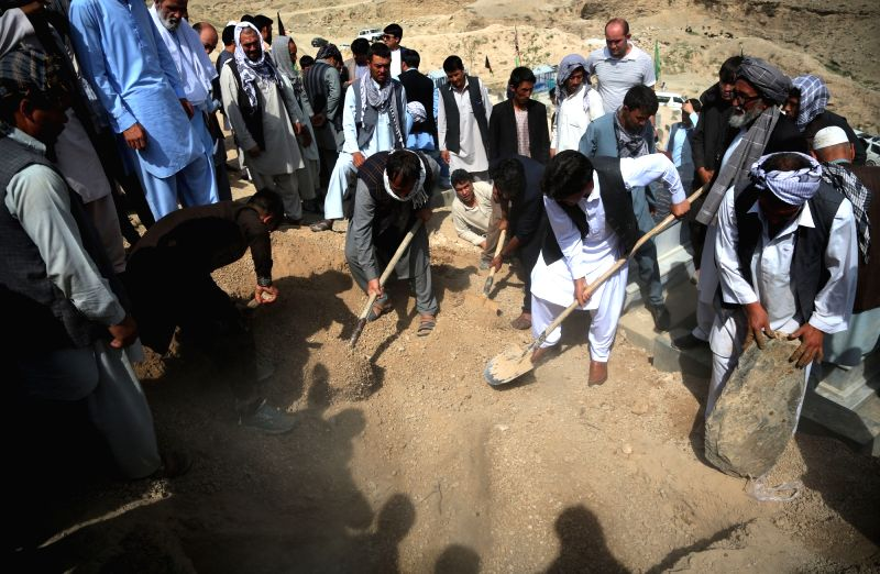 KABUL, July 16, 2018 - Friends and relatives throw earth on the tomb of a suicide attack victim in Kabul, capital of Afghanistan, July 16, 2018. Up to 1,692 Afghan civilians were killed as a result ...