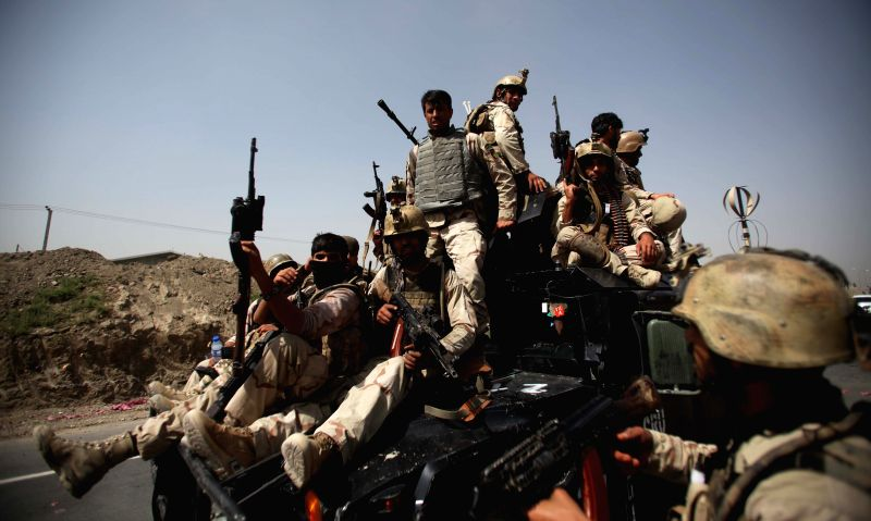 Afghan soldiers leave while shout slogans against Taliban at the site of attack in Kabul, Afghanistan, July 17, 2014. A group of Taliban militants attacked the ...
