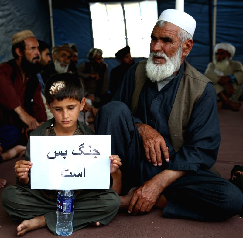 "KABUL, July 19, 2018 - A boy holds a sign that reads ""War is enough"" during a rally calling for peace in Kabul, Afghanistan, July 19, 2018. The NATO-led Resolute Support (RS) mission ..."