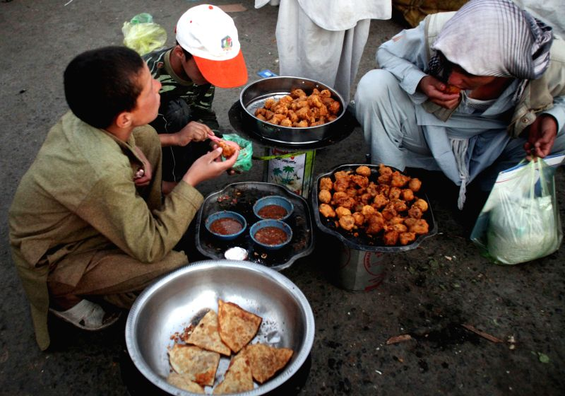 Afghan men break their fast with traditional food during holy month of Ramadan in Kabul, Afghanistan, July 22, 2014. ****Authorized by ...