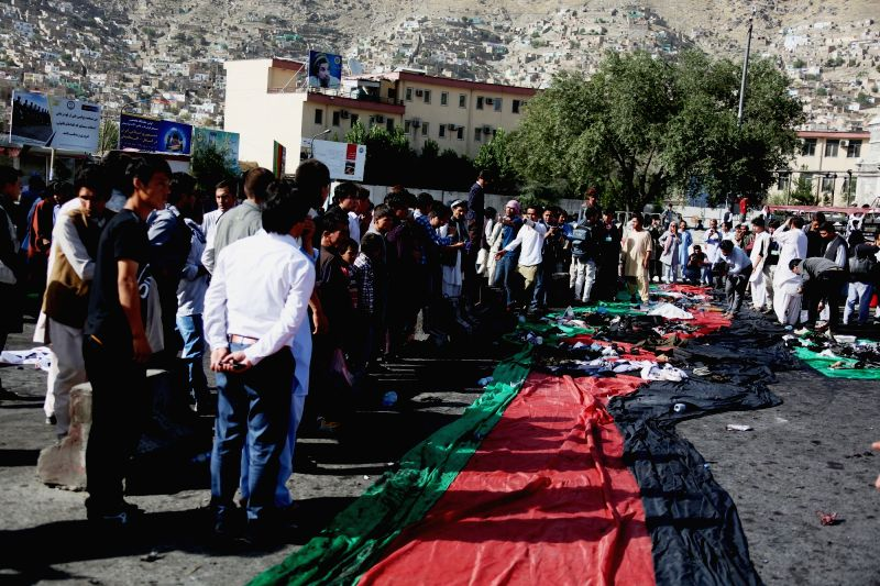 KABUL, July 23, 2016 - People gather at the site of a blast in Kabul, capital of Afghanistan, July 23, 2016. At least 61 people were killed and some 207 others wounded after a deadly blast hit a ...