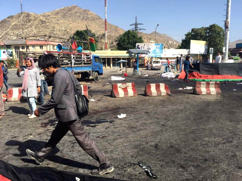 KABUL, July 23, 2016 - People walk past the blast site in Kabul, Afghanistan, on July 23, 2016. The death toll has risen to 20 while 160 others wounded after a deadly blast ripped through a ...