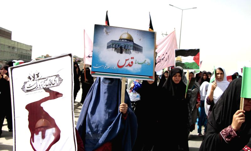Protesters attend a protest against Israel's attack on Gaza in Kabul, Afghanistan, July 25, 2014.