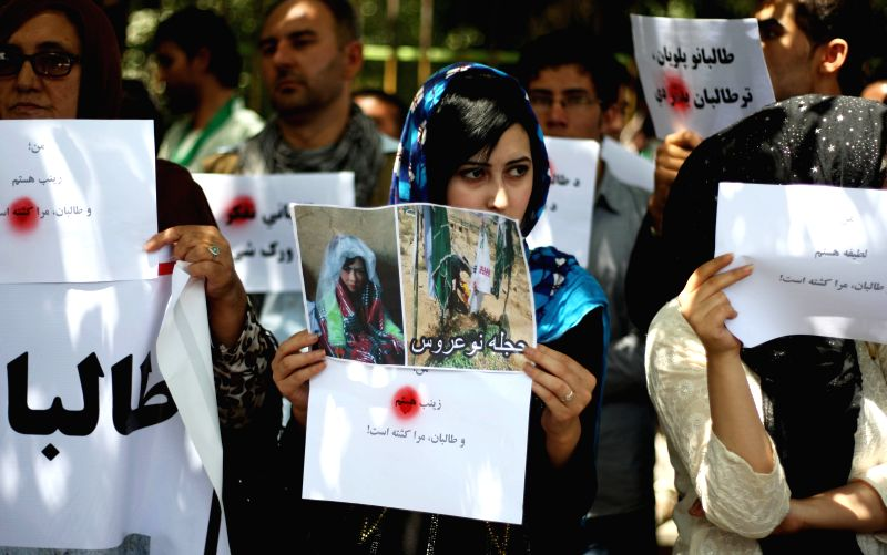 Afghan protesters hold placards during a protest against Taliban in Kabul, Afghanistan, July 27, 2014. Hundreds of Afghans staged a protest to condemn Taliban's ...