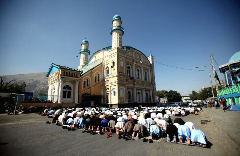 Afghan men attend Eid-al-Fitr prayers at a mosque in Kabul, Afghanistan, on July 28, 2014. Muslims around the world celebrate Eid al-Fitr, marking the end of the ...