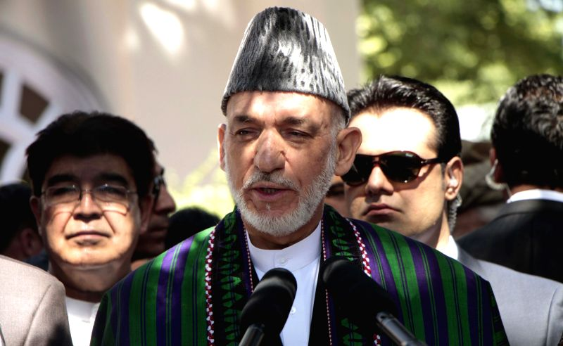 Afghan president Hamid Karzai (C) talks to the media after the Eid al-Fitr prayer in Kabul, Afghanistan, on July 28, 2014. President Hamid Karzai offered Eid prayer ..