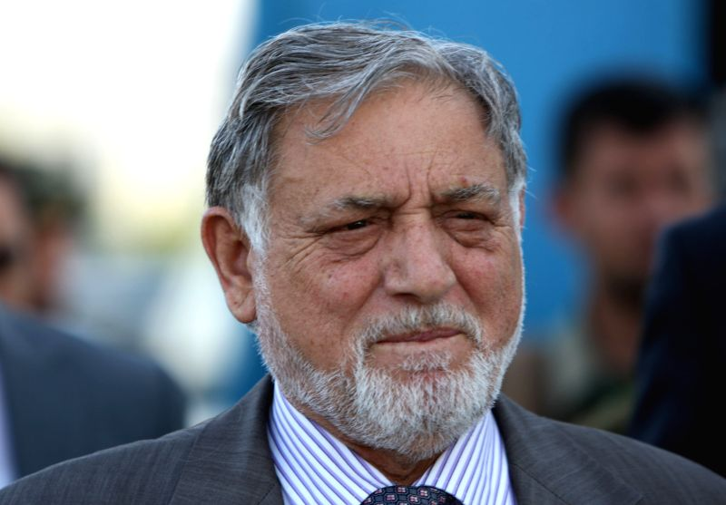 Chairman of the Afghan Election Commission Ahmad Yusuf Nuristani arrives for a press conference in Kabul July 7, 2014. Presidential candidate Ashraf Ghani Ahmadzai was