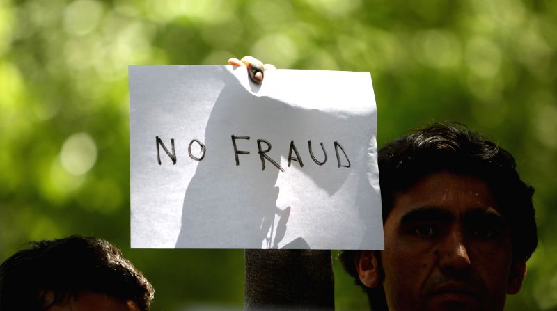 Afghan protesters gather during a protest against alleged election irregularities and fraud in Kabul June 18, 2014. Afghans staged a peaceful protest in Kabul on ...