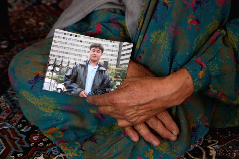 KABUL, June 19, 2017 - Fatima, mother of Hussain Panae, victim of a terrorist attack in Kabul on May 31, holds a picture of her son at their home in Kabul, capital of Afghanistan, on June 15, 2017. A ... - Wazir Akbar Khan