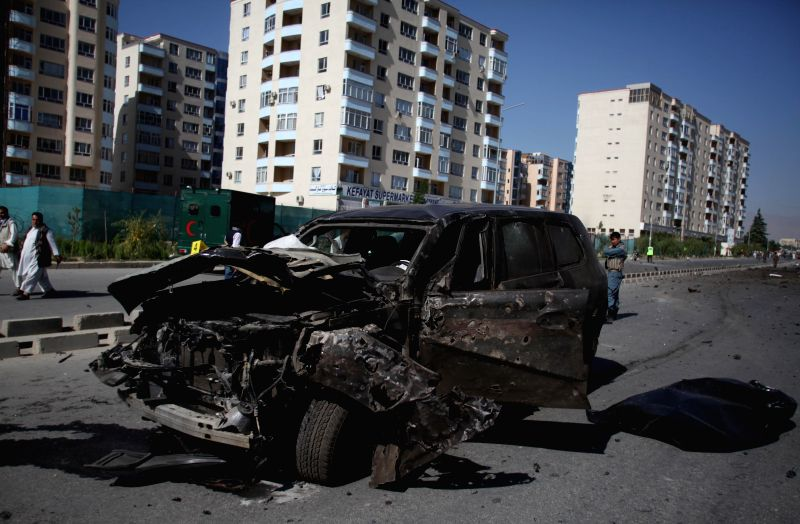 A destroyed armed vehicle is seen at the site of suicide car bombing in Kabul, Afghanistan, June 21, 2014. One civilian was killed and three others wounded Saturday ..