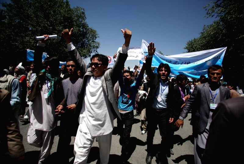 Afghan protesters shout slogans while taking part in a protest against alleged election irregularities and fraud in Kabul, Afghanistan, June 21, 2014. Hundreds of ...