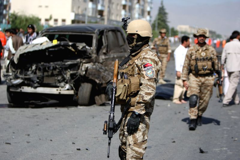 Afghan security forces inspect the site of suicide car bombing in Kabul, Afghanistan, June 21, 2014. One civilian was killed and three others wounded Saturday morning