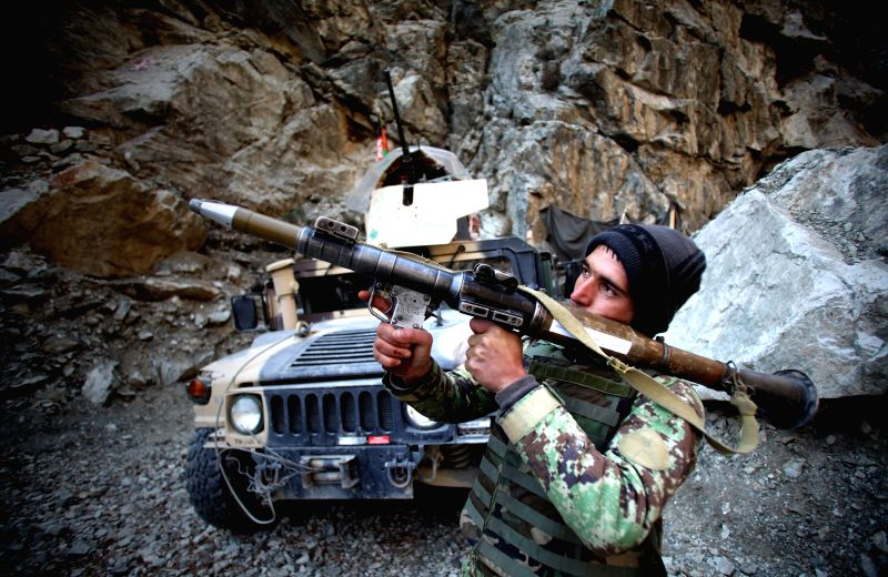 An Afghan National Army soldier holds a RPG (Rocket Propelled Grenade) at an army checkpoint in Sourbi district of Kabul, Afghanistan, March 14, 2015. Some nine ...