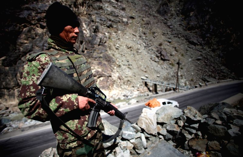 An Afghan National Army soldier stands guard at an army checkpoint in Sourbi district of Kabul, Afghanistan, March 14, 2015. Some nine militants have been killed in ...