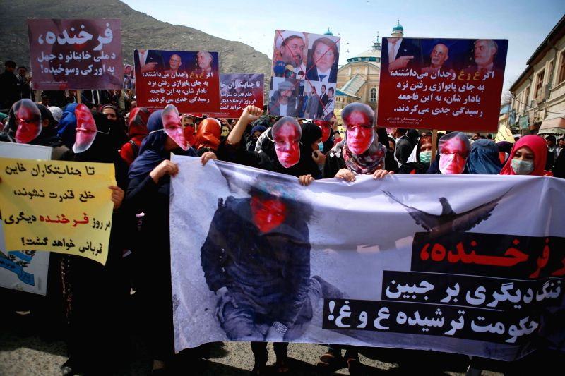 Members of the Solidarity Party of Afghanistan wearing masks of bloodied faces attend a protest at the site where a mob beat a woman to death in Kabul, Afghanistan, ...