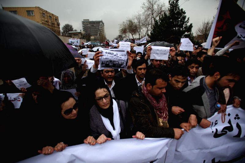 Afghan people attend a protest demanding justice for a woman who was beaten to death in Kabul, Afghanistan, March 24, 2015. An angry mob beat a woman to death and ...