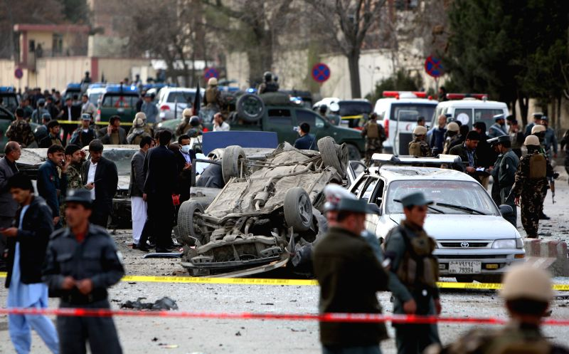 Destroyed vehicles are seen at the site of a suicide bombing in Kabul, Afghanistan, March 25, 2015. The suicide bombing that rocked Kabul city on Wednesday killed ...