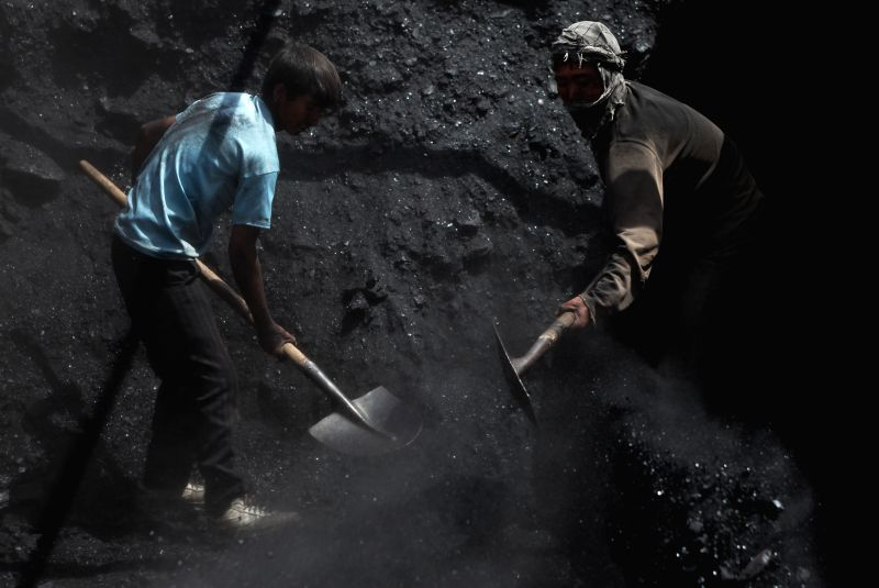 Afghan labors unload coal from a truck at a factory on the International Labor Day in Kabul, Afghanistan, May 1, 2014. At least 17 people were killed while several ...