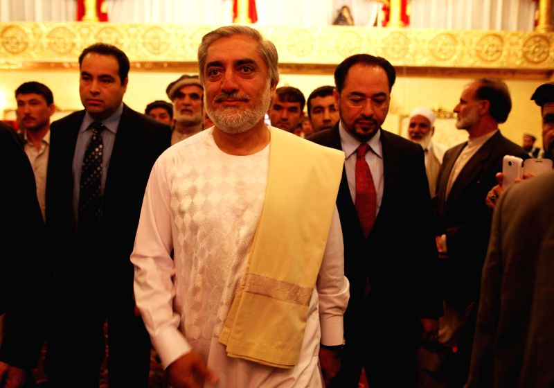 Afghan presidential candidate Abdullah Abdullah (front) arrives for a joint press conference in Kabul, Afghanistan, May 11, 2014. Afghan presidential candidate Dr. ...