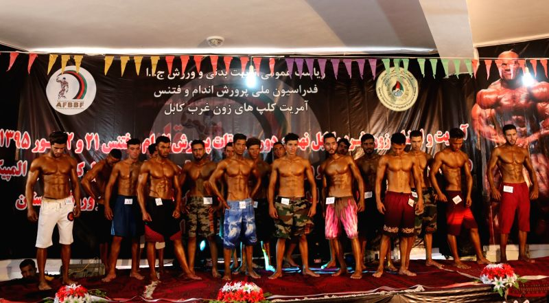KABUL, May 12, 2016 - Body builders pose for a photo during a competition in Kabul, Afghanistan, May 11, 2016. A body builder competition was held in Kabul, capital of Afghanistan on Wednesday. About ...