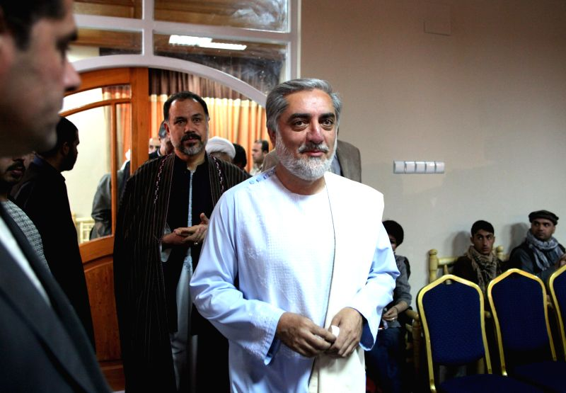 Afghan presidential candidate Dr. Abdullah Abdullah(C) arrives for a press conference in Kabul, Afghanistan on May 15, 2014. Afghan presidential runner Dr. Abdullah ...