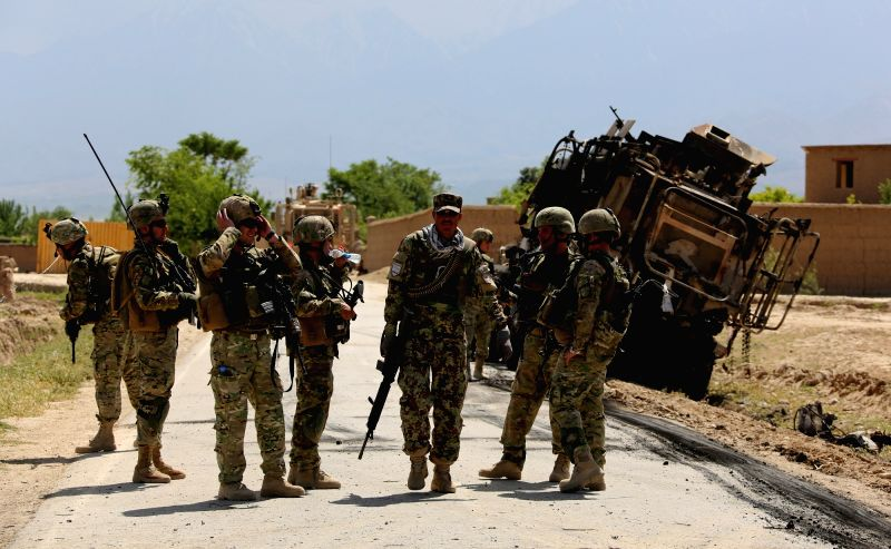 KABUL, May 21, 2016 - NATO-led Resolute Support soldiers inspect the site of a suicide attack in Bagram district of Parwan province, Afghanistan, May 21, 2016. A suicide car bombing hit a foreign ...