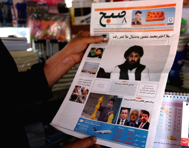 KABUL, May 23, 2016 - An Afghan man reads the news of Taliban leader's death on a local news paper in Kabul, capital of Afghanistan, May 23, 2016. Taliban leader Mullah Akhtar Mansoor had been ...