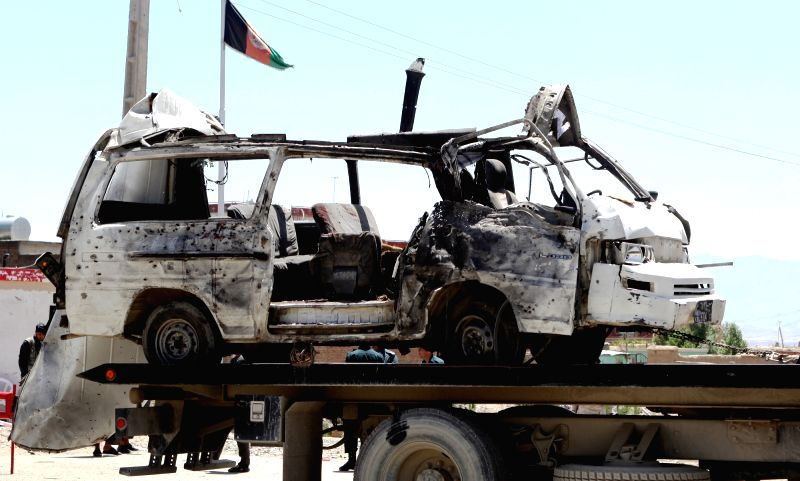 KABUL, May 25, 2016 - Photo taken on May 25, 2016 shows a damaged bus after a suicide bombing in Kabul, capital of Afghanistan. A suicide bomber struck a bus carrying employees of a local court in ...