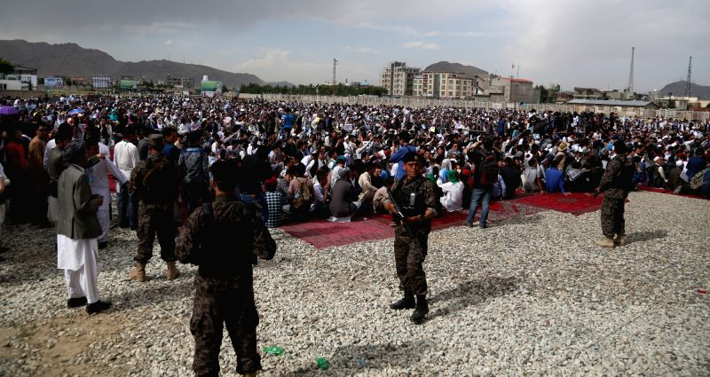 KABUL, May 28, 2016 - Afghan security personnel stand guard during a protest in Kabul, capital of Afghanistan, on May 27, 2016. Thousands of Afghans gathered at a mosque west of Kabul on Friday to ...
