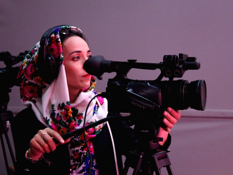 KABUL, May 28, 2017 - Salma Rasa, 26, records a program at Zan TV in Kabul, capital of Afghanistan, May 23, 2017. The first-ever woman television channel, Zan TV, in Afghanistan has been established ...
