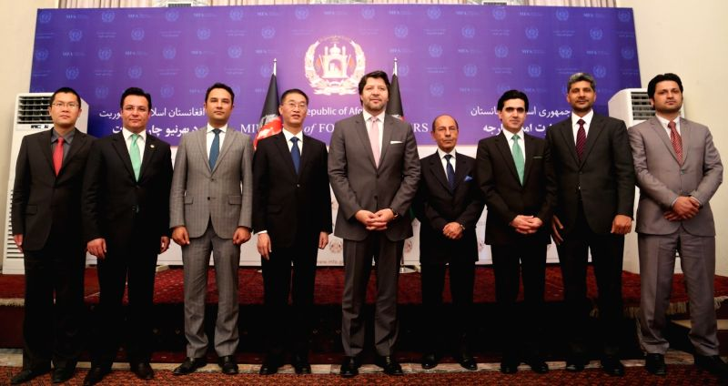 "KABUL, May 8, 2016 - Afghan Deputy Foreign Minister Hekmat Khalil Karzai (5th R) and Chinese Ambassador to Afghanistan Yao Jing (4th L) pose for photo during ""One Belt one Road"" seminar in ... - Hekmat Khalil Karzai"