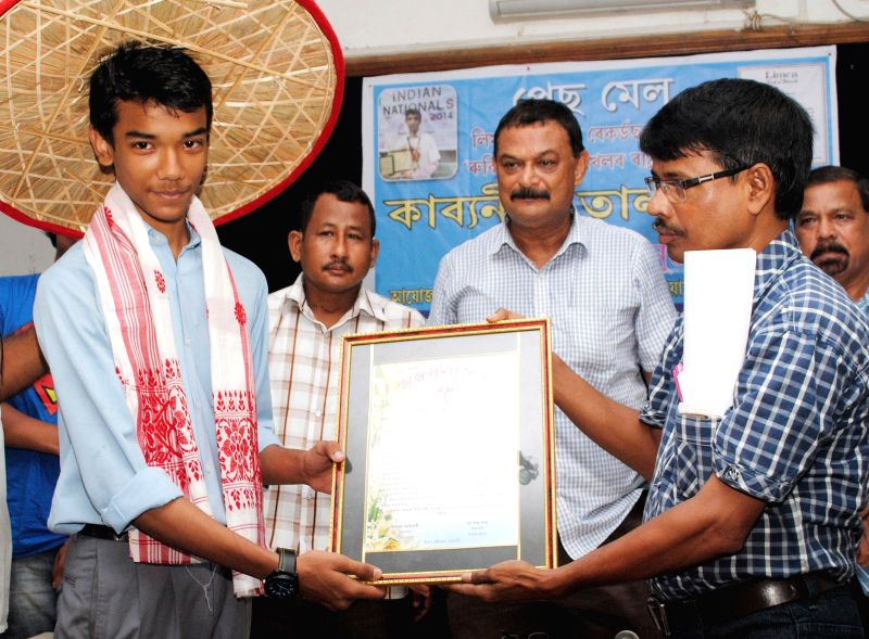 Kabyanil Talukdar being felicitated during a programme organised by Mind Sports Foundation in Guwahati on Aug 7, 2014. Kabyanil Talukdar holds a  Limca Book record of solving 3X3 Rubik's Cube ...