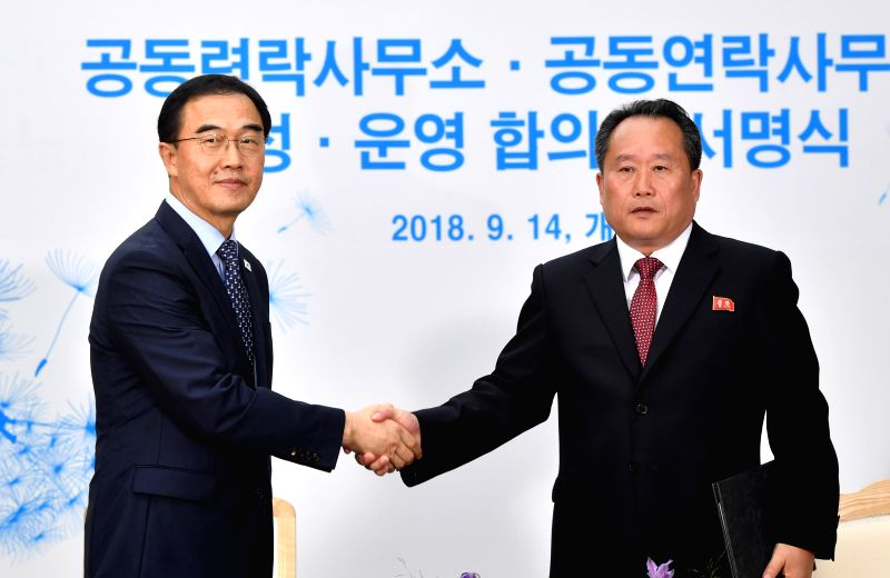 KAESONG, Sept. 14, 2018 - South Korean Unification Minister Cho Myoung-gyon (L) shakes hands with Ri Son Gwon, chairman of the Committee for the Peaceful Reunification of the Fatherland (CPRF) of the ... - Cho Myoung