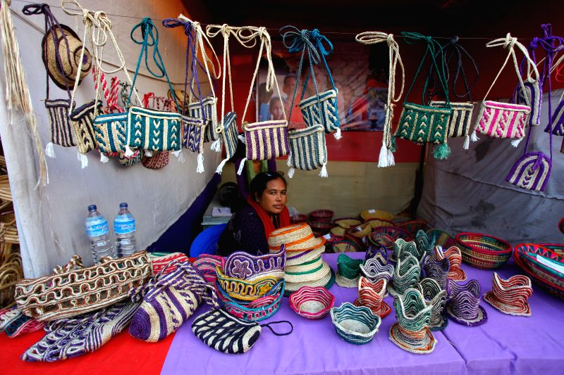 A local vendor displays the local products at the Far Western Fair at Dhangadhi in Kailali, Nepal, Dec. 12, 2014. The fair was organized to promote the local products and culture. ...
