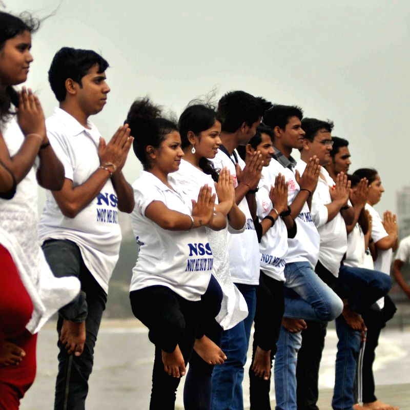Kaivalyadhama Yoga Institute perform Yoga to celebrated ``World Yoga Day`` at marine Drive in Mumbai on June 21, 2014.