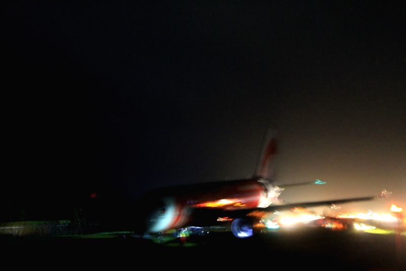 Photo taken on Dec. 30, 2014 shows an AirAsia jet that overshoots the runway of Kalibo International Airport in Kalibo, the Philippines. An AirAsia jet which arrived