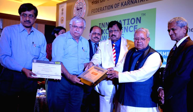 Kalraj Mishra, Union Minister of MSMEs presenting Innovation Excellence MSME Awards, during Innovation Excellence MSME Award presentation ceremony organized by FKCC at Hotel Lalita Ashok, also seen .. - Kalraj Mishra