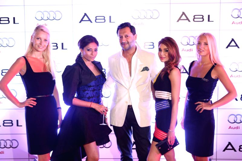 Kalyani Chawla, Vikram Waliya and Niamat Bakshi during the launch of Audi A8L in Dubai. - Niamat Bakshi