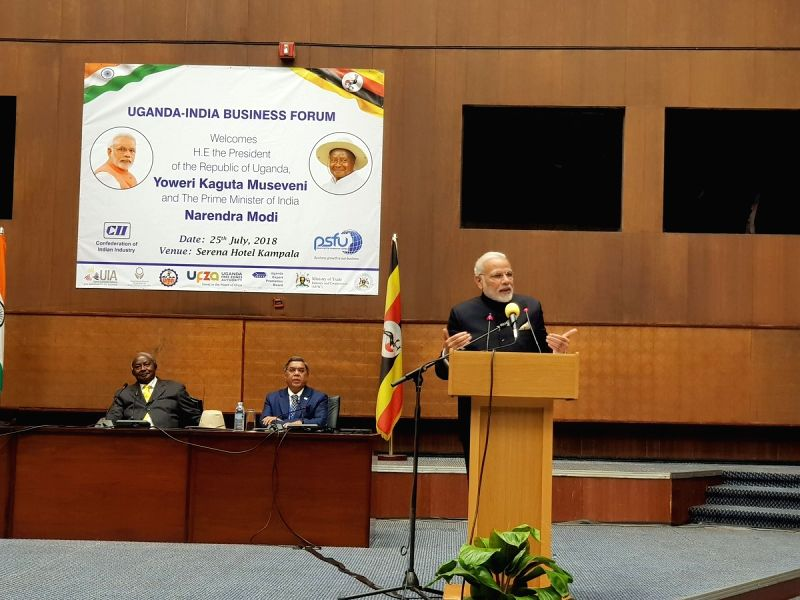 : Kampala: Prime Minister Narendra Modi addresses during India-Uganda Business Forum in Kampala, Uganda on July 25, 2018. Also seen Uganda President Yoweri Kaguta Museveni. (Photo: IANS/MEA).