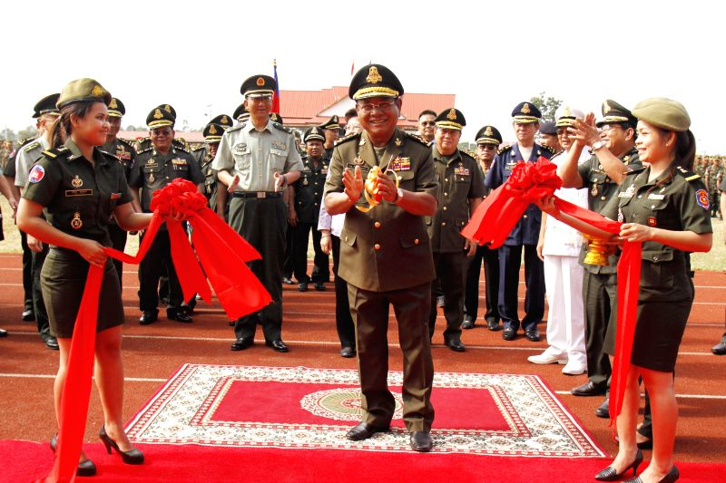 Pol Saroeun (C, front), commander-in-chief of the Royal Cambodian Armed Forces, cuts the ribbon to inaugurate a China-funded building in Kampong Speu province, .