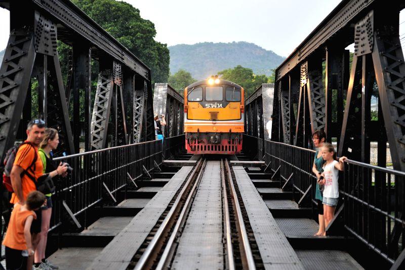 "A train runs on the rebuilt ""Bridge on the River Kwai"" in Kanchanaburi Province, Thailand, April 30, 2014. The original ""Bridge on the River ..."
