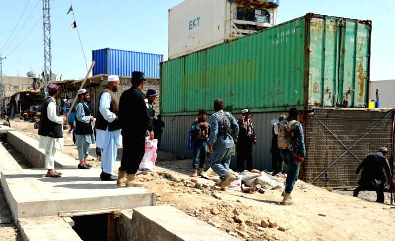 KANDAHAR, April 6, 2016 - Afghan security force members inspect the site of a suicide attack in Kandahar province, Afghanistan, April 6, 2016. One civilian was killed and another injured as a suicide ...